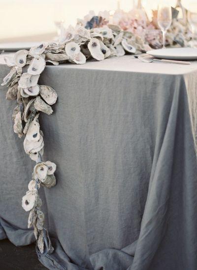 Beach-wedding-reception-oyster-garland-centerpiece-600x822